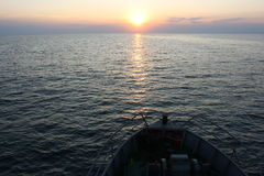 Sea sunset 2. On the way to the Zmeiniy island Stock Photos
