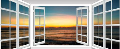 Sea sunset from the window royalty free stock photo