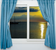 Sea sunset from the window Stock Image