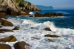 Sea surf. Surf of coastal rocks and cliffs shot on hi shutter speed Royalty Free Stock Images