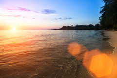 Sea surf on the beach during beautiful sunset. Travel. Royalty Free Stock Images