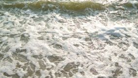 Sea surf at beach. (Handheld shot stock video