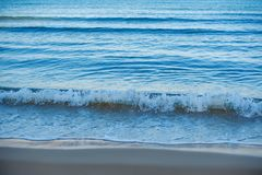 The sea surf at dawn. Deeply blue and beautiful in the morning in Israel stock image