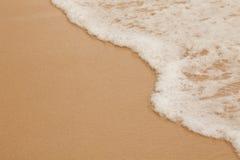 Sea surf macro on sand beach Stock Images