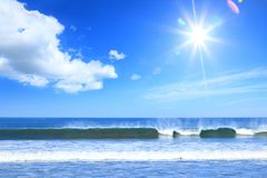Sea surf. At the pacific ocean coaston a background of the sun and blue sky stock photo