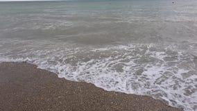 Sea surf on pebble beach stock footage