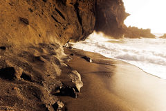 Sea surf on the rocks in area  La Pared on Fuerteventura Stock Images