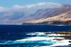 Sea surf on the rocks in area  Punta Pesebre  on Fuerteventura Stock Image