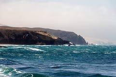 Sea surf on the rocks in the   La Pared on Fuerteventura Stock Photo