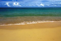 Sea surf on the sandy beach, seascape. Sea surf on the sandy beach. sea view with sky with white clouds Royalty Free Stock Images