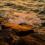 Sea surf splashing Stock Photography