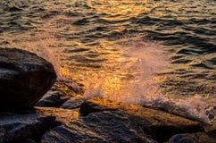 Sea surf splashing Stock Images