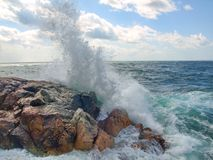 Sea surf. Splits waves against rocks in the sea Stock Photography