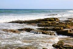 Sea surf and spray on the beach royalty free stock photos