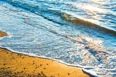 Sea surf on the sunny beach Royalty Free Stock Photos