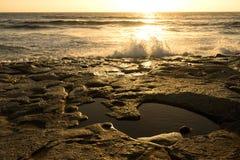 Sea surf  at sunset in area  La Pared on Fuerteventura Stock Photos