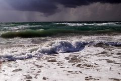 Sea surf in a thunder-storm. Mediterranean, Sardinia, Italy Royalty Free Stock Image