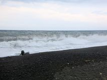 Sea surf and waves crashing onto the beach stock image
