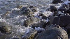 Sea surf. Waves runs on coastal pebble. Sea surf. Waves runs on coastal pebble 4k stock video