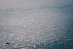Sea surface aerial view. A small boat Stock Photo