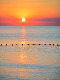 Sea surface against the sunset sky. Beautiful seascape Stock Images