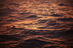 Sea surface background in sunset or sunrise time and feeling alone. wave of water or sea flowing with turbulent in the nature. Stock Images