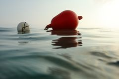 Sea surface photographed from water level, sea buoy in back. Abstract marine background.  stock images