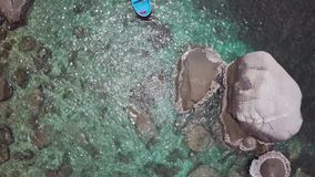 Sea Surface Ripple at Sunlight with Transparent Clear Water and Visible Sandy Bottom with Underwater Rocks. Aerial Top. View shot with a DJI Mavic fps 29,97 4k stock video footage