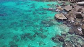 Sea Surface Ripple at Sunlight with Transparent Clear Water and Visible Sandy Bottom with Underwater Rocks. Aerial Top. View shot with a DJI Mavic fps 29,97 4k stock footage