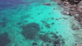 Sea Surface Ripple at Sunlight with Transparent Clear Water and Visible Sandy Bottom with Underwater Rocks. Aerial Top. View shot with a DJI Mavic fps 29,97 4k stock video