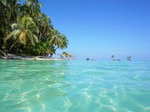 Sea surface with turquoise water and island shore Stock Photos