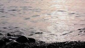Sea surface with woman legs stock footage