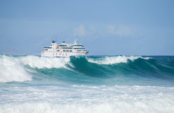 Sea swell and ferry Royalty Free Stock Photo