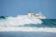 Sea swell and ferry Stock Photo