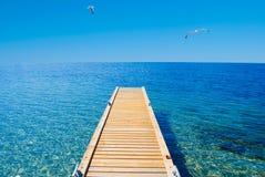 Sea, Swim and Sun... A deck in a desert island Stock Photos