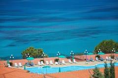 Sea with swimming pool stock image