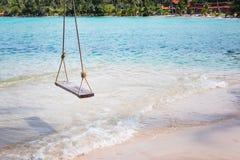 Sea swing beside the sea on tropical beach Stock Photography