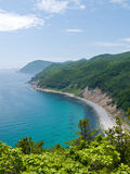 Sea and Taiga 6. The view from above on small bay. Azure and summer. Russian Far East, Primorye, state nature reserve Lazovsky, Japanese sea, Uglovaya bay Stock Photography