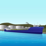 Sea tanker loading at an oil storage Stock Images
