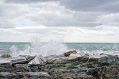 Sea in tempest on rocks of italian village Stock Photography