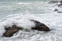 Sea in tempest on rocks of italian village Stock Images