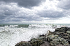 Sea in tempest on rocks of italian village Royalty Free Stock Photography