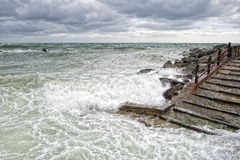Sea in tempest on rocks of italian village Stock Image