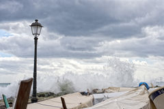 Sea in tempest on rocks of italian village Stock Photography