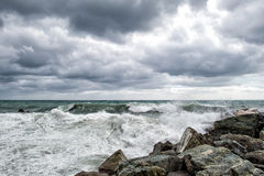 Sea in tempest on rocks shore Stock Image
