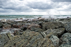 Sea in tempest on rocks shore Royalty Free Stock Photo