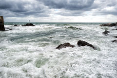 Sea in tempest on rocks shore Stock Photos