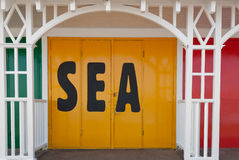 Sea. Text on a Yellow Beach Hut Door Stock Images