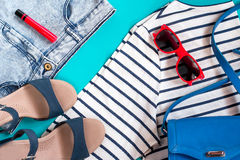 Sea theme female summer clothing collection. Top view royalty free stock photography