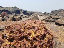Rocky beach shore. From the sea there are sharp, long and short stones Royalty Free Stock Photography